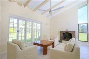 Living area, high ceiling, fireplace, French window views